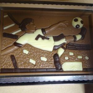 Voetballer in actie in melkchocolade